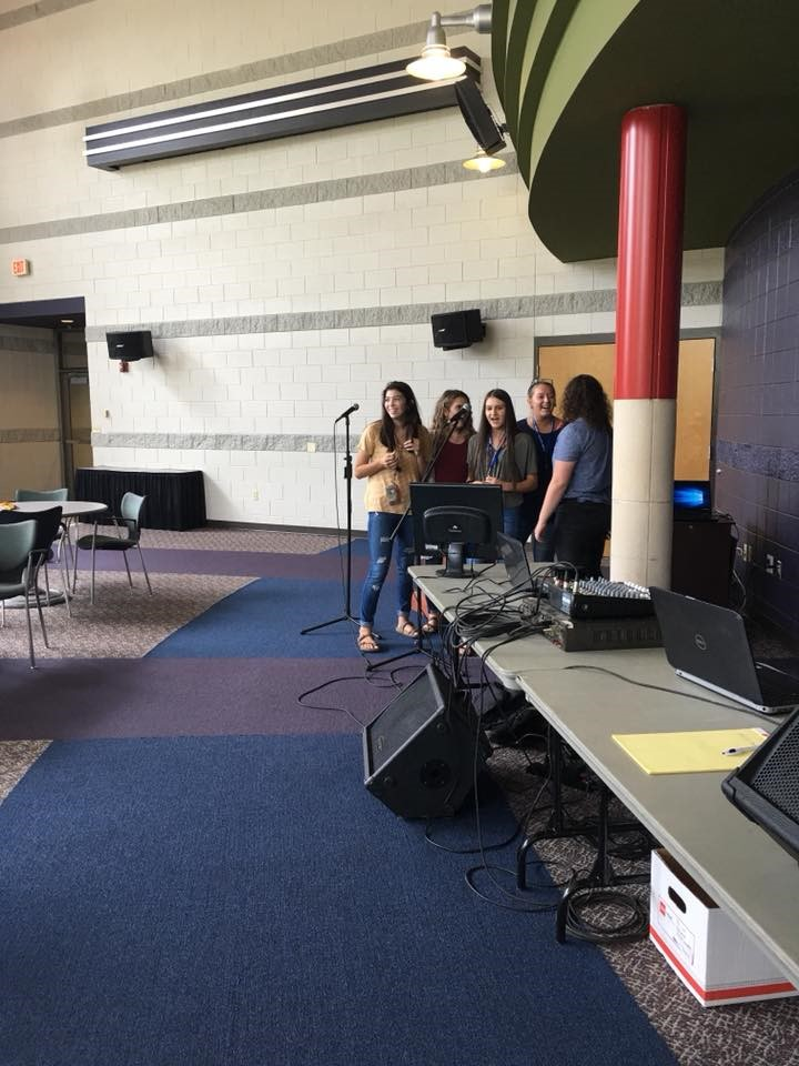Students participating in karaoke