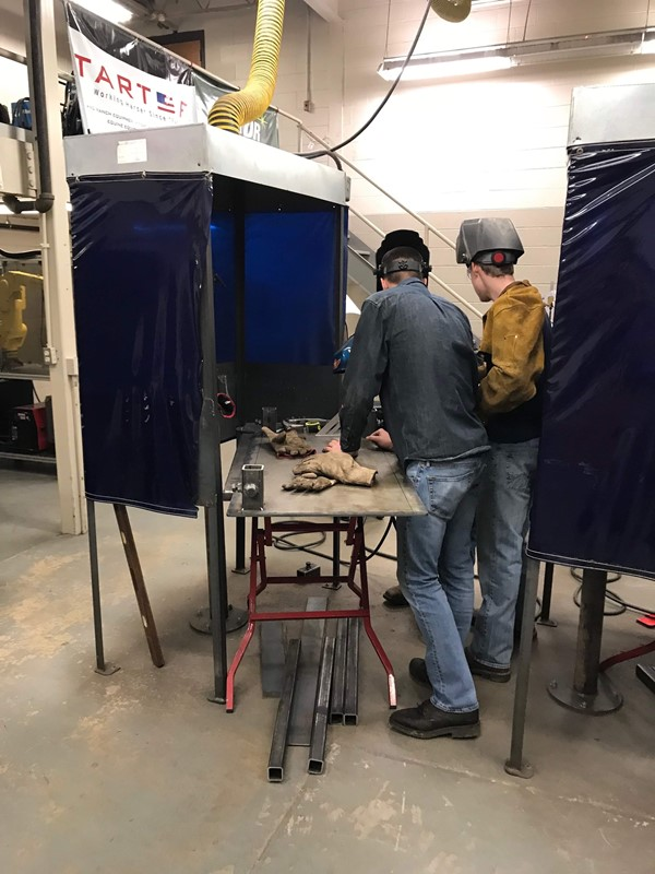 (L-R) Kelby Stinson and John Simpson welding