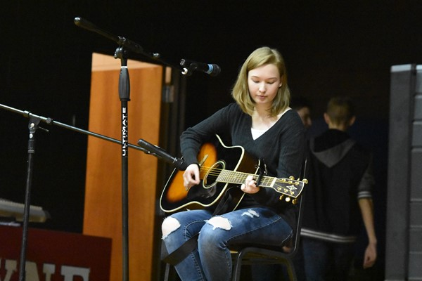 Abby Smith performing on her guitar