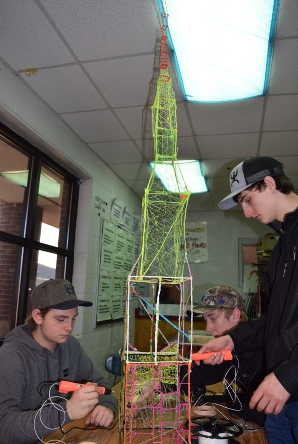 Juniors (L-R) Tanner Floyd, Cody Bransum, and Colton Barnett working on beating the Guinness World Record of tallest 3-D pen sculpted tower