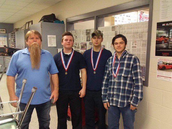 (L-R) Mark Burke with his students Jaden Gibson (Automotive Technology MLR Service - 2nd place), Micheal Cooper (Automotive Technology MLR Service - 3rd place), and Johnathan Mansfield (Transportation Tool Identification - 2nd place)