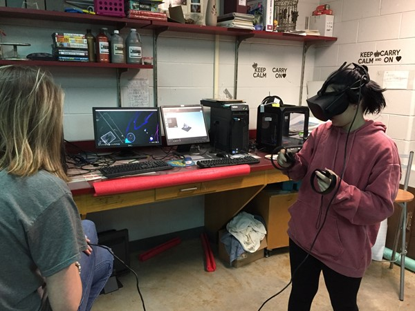Student painting in a virtual reality simulation
