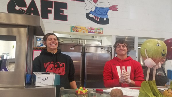 WCHS Athletes Nathan Burks and Kameron Gehring serving the students at Bell Elementary