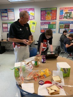Randy Foster helps students make sandwiches