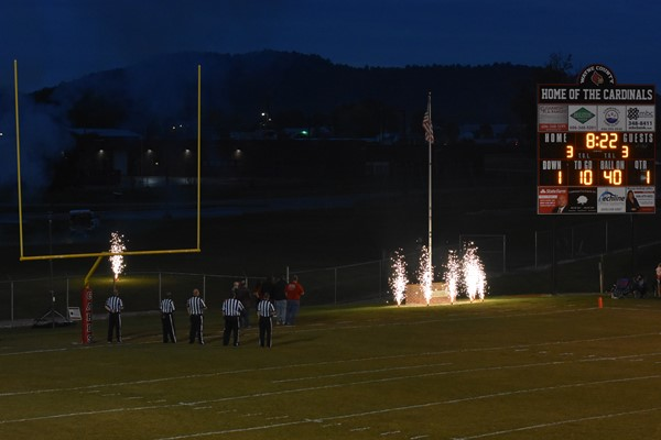 Referees with the fireworks at the football game
