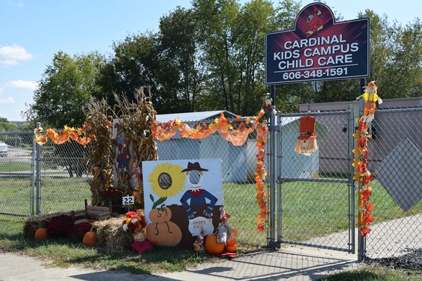 Cardinal Kids Campus Child Care Display #22 behind Walker Early Learning Center by gate to the playground
