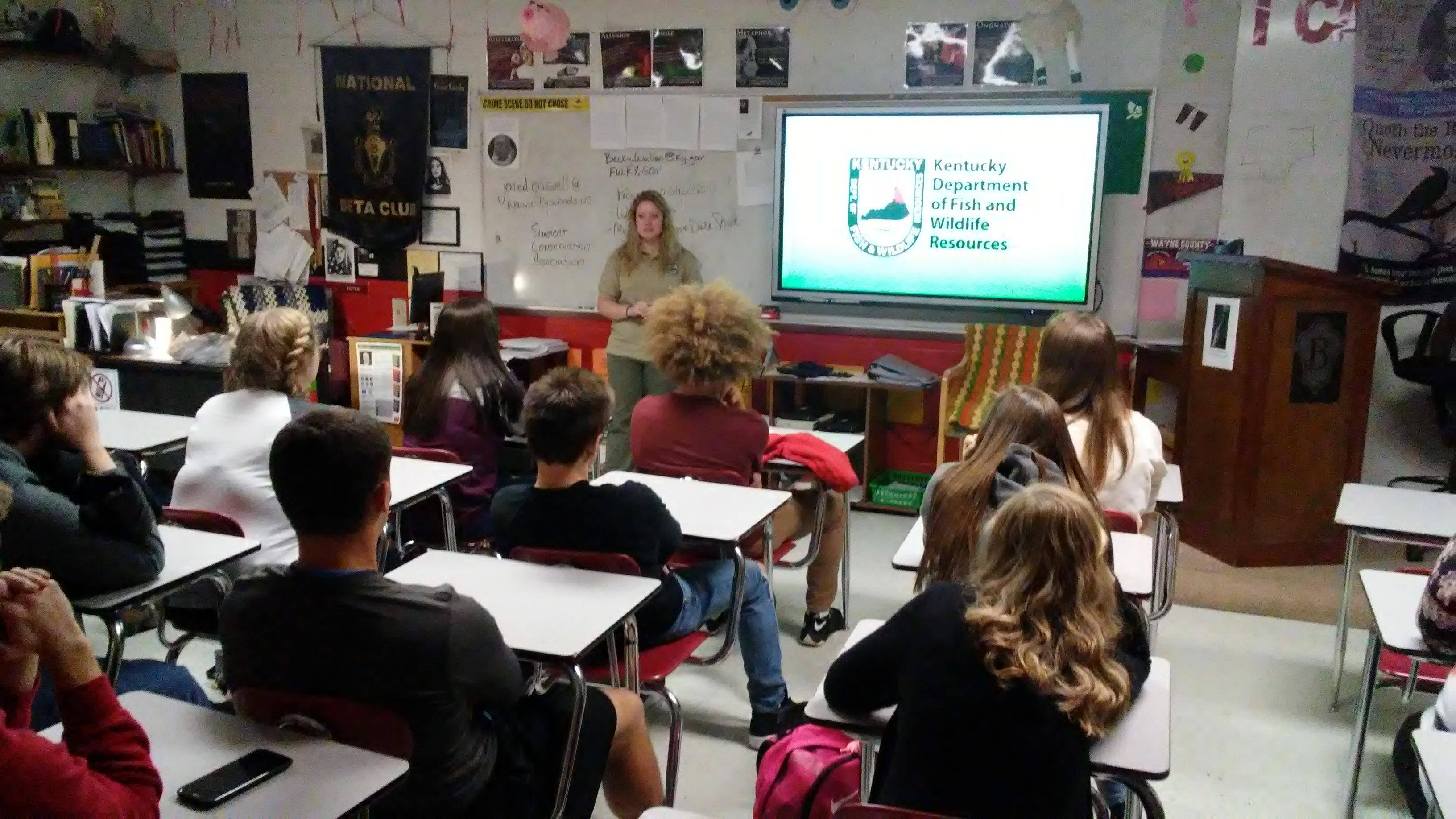 Fish and Wildlife Department Worker speaks to English classes
