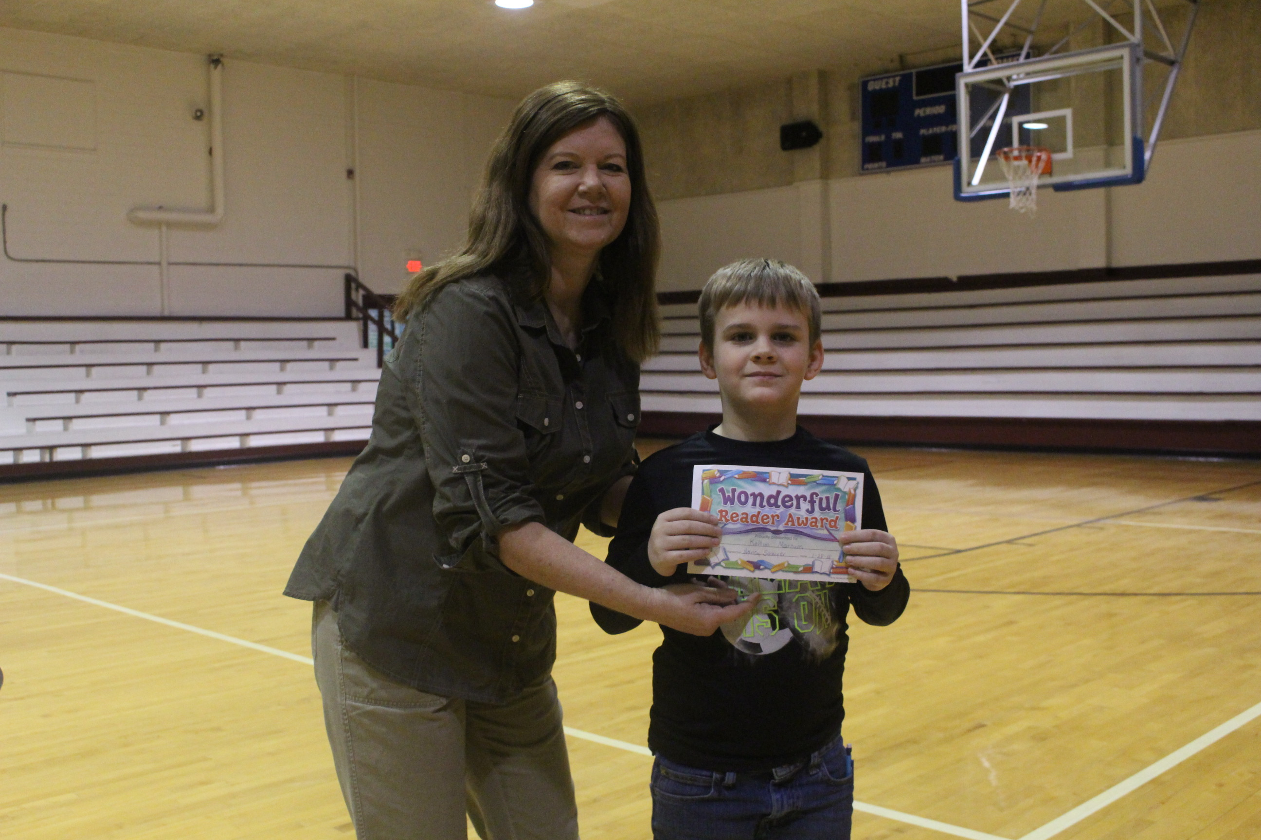 Counselor Demetria Cooper presented a Wonderful Reader award to Kolton Marcum