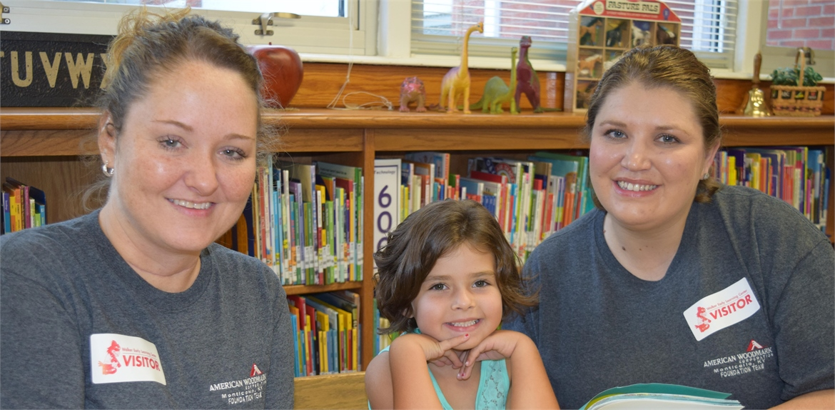 American Woodmark Foundation team members enjoy reading stories at Walker