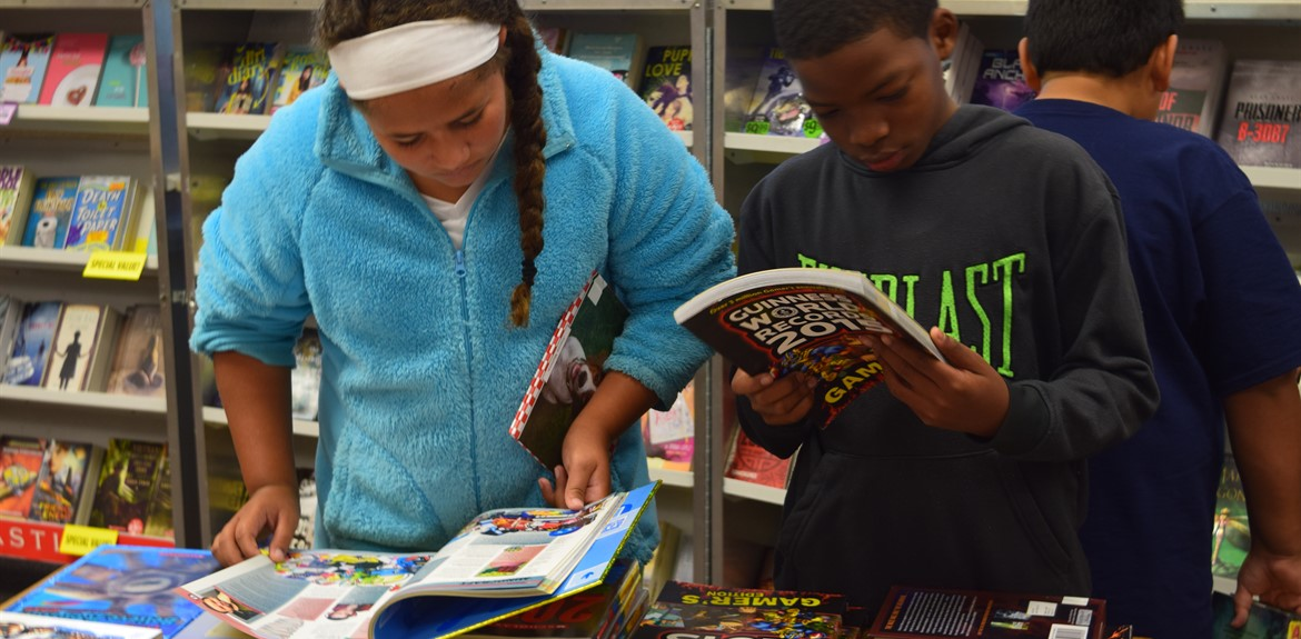 Students enjoy the book fair held in WCMS Media Center