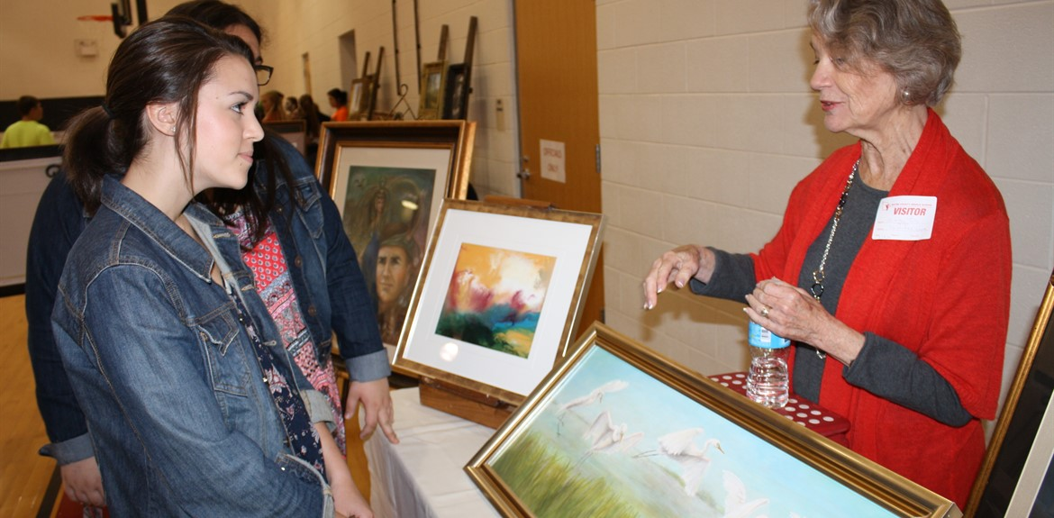 Students enjoy an art exhibit sponsored by local artists