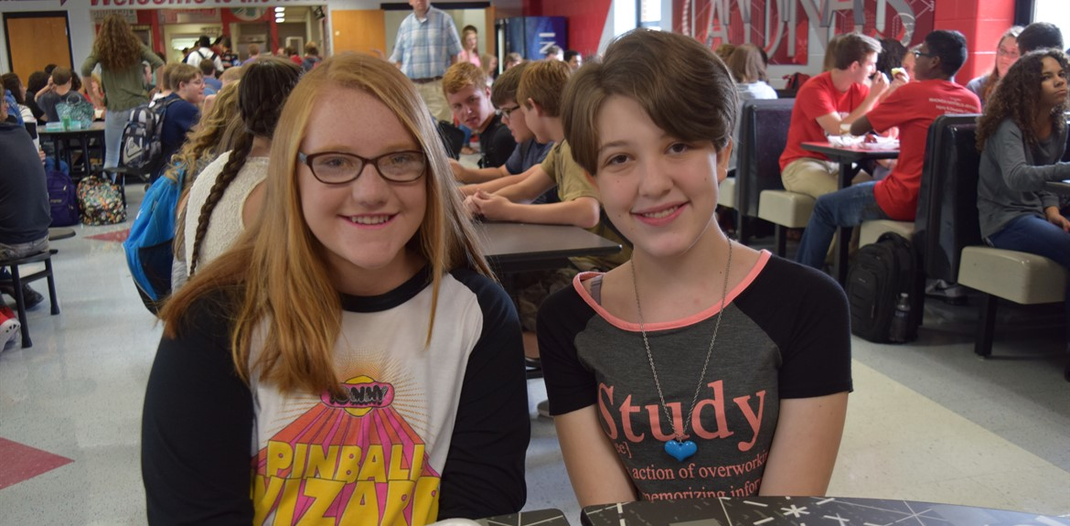 Emily Loveless and Calista Kulpa enjoy lunch in the redecorated High School cafeteria