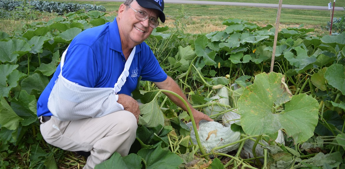 County Agriculture Extension Agent Glen Roberts showed off one of the newest squash selections in the school garden