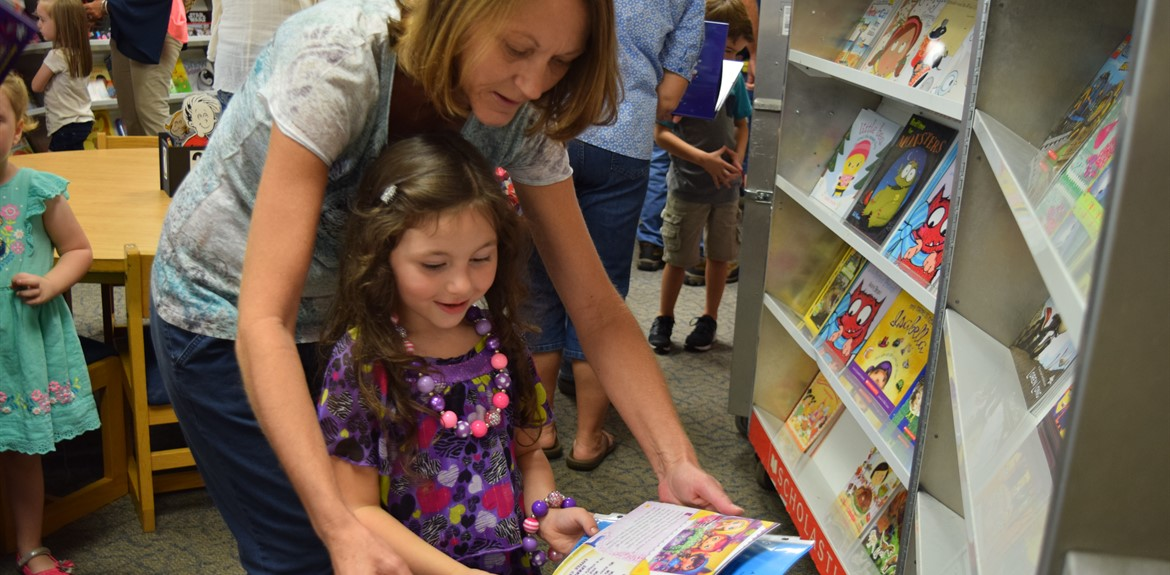 Aubrey Morrow enjoys the Walker Early Learning Center book fair with grandmother Brenda Kempton