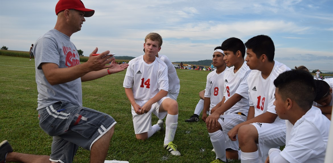 Coach Bradley Askins motivated his players during a time out at a boys soccer game