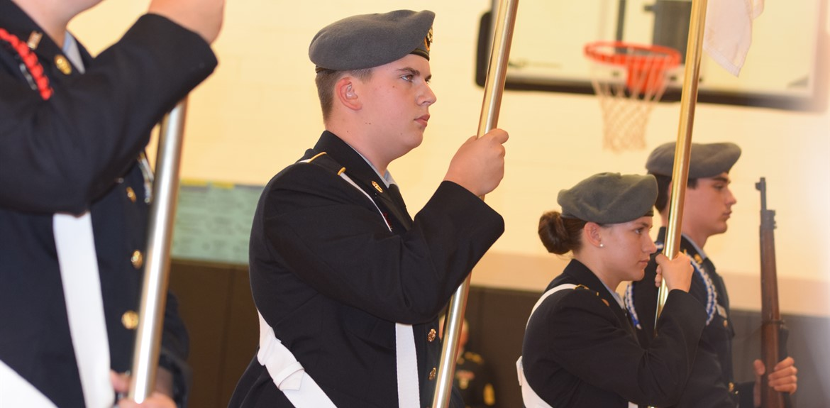 The JROTC Color Guard presents the Armed Forces Service Flags at Bell's Veteran's Day Program