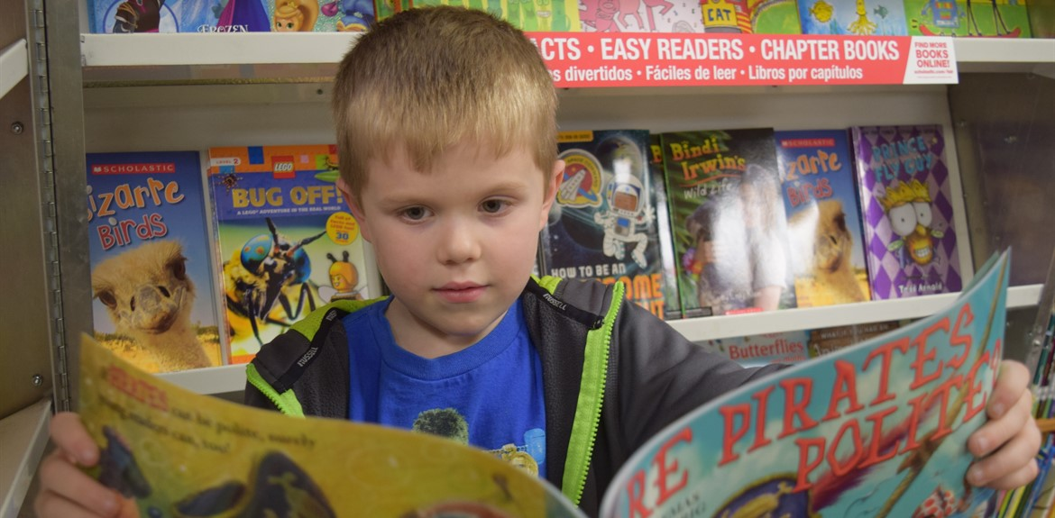 Kindergarten student Owen Harris and his classmates love to shop at the school library book fair
