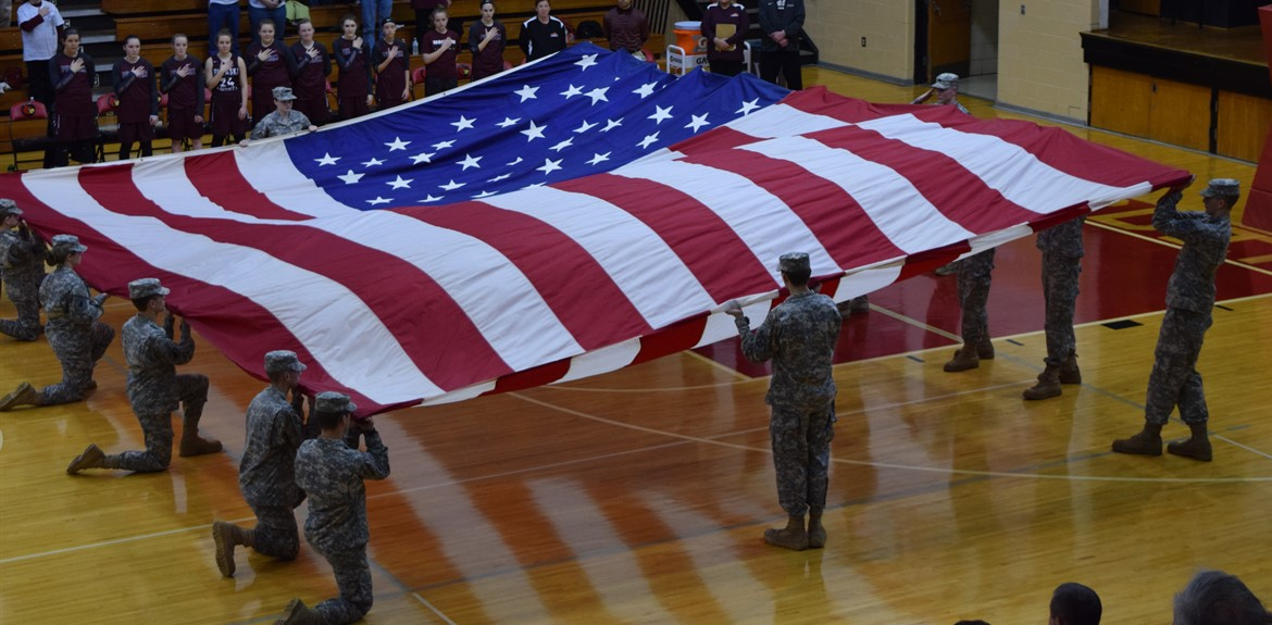 JROTC displays Garrison Flag at Lady Cardinals winning basketball game against Pulaski