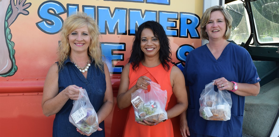 WC School Board members enjoy meals from Lunchbox Express, a summer feeding program provided by the school