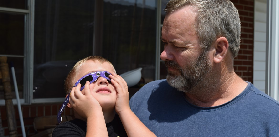 Preschooler Brincyn Pope checked out the eclipse with his grandfather Teddy Simpson, a Wayne County School Bus Driver.