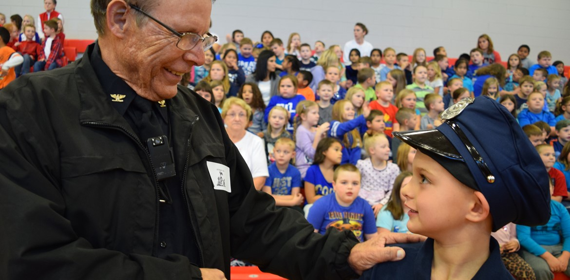 Police Chief Ralph Miniard shakes hands with Bell Elementary student at Veterans Program