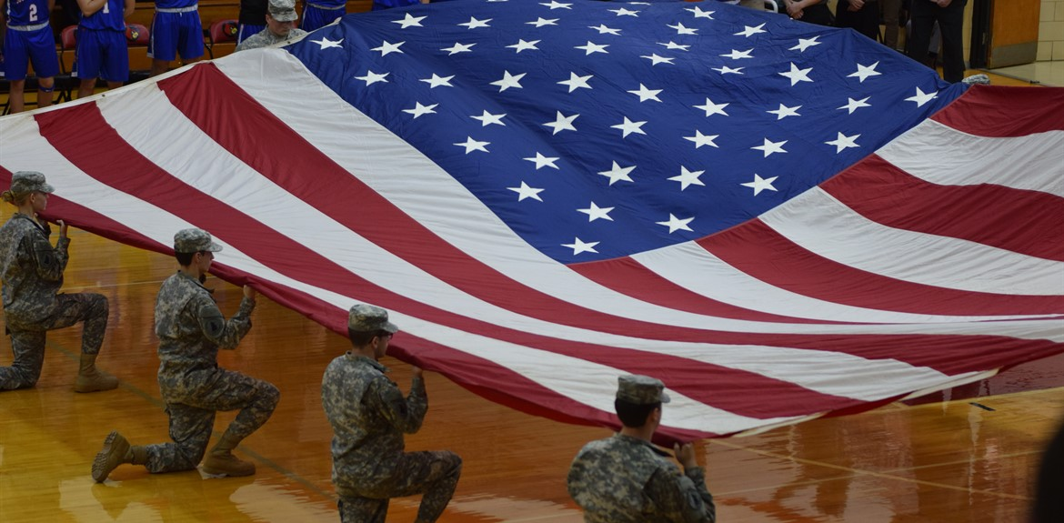 JROTC presents Garrison Flag at the doubleheader basketball game on January 25th