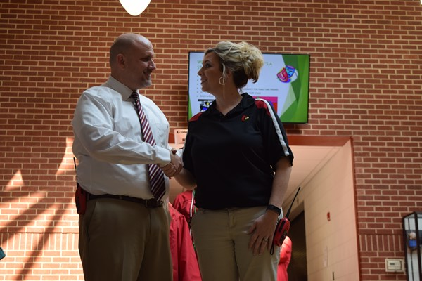 WCHS Principal Justin Alley is greeted by WCMS Principal Melissa Gossage