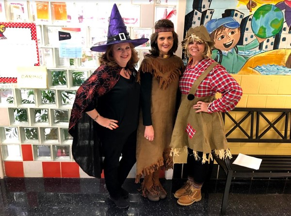 Susan Helms, Nell Boils, Lois Brady dressed up for Literacy Night