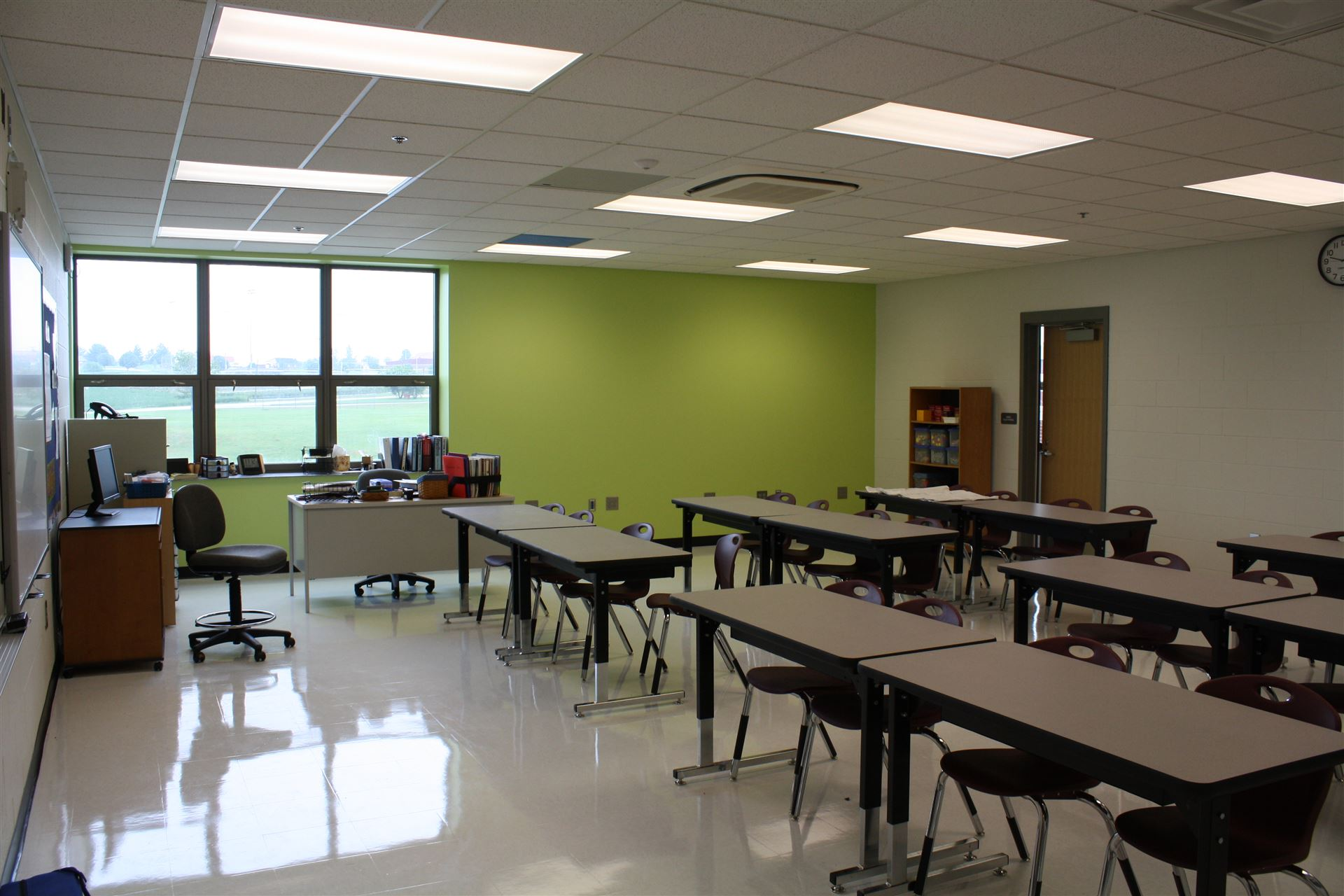 Modern Middle School Classroom ~ Find preparations underway for the start of school on