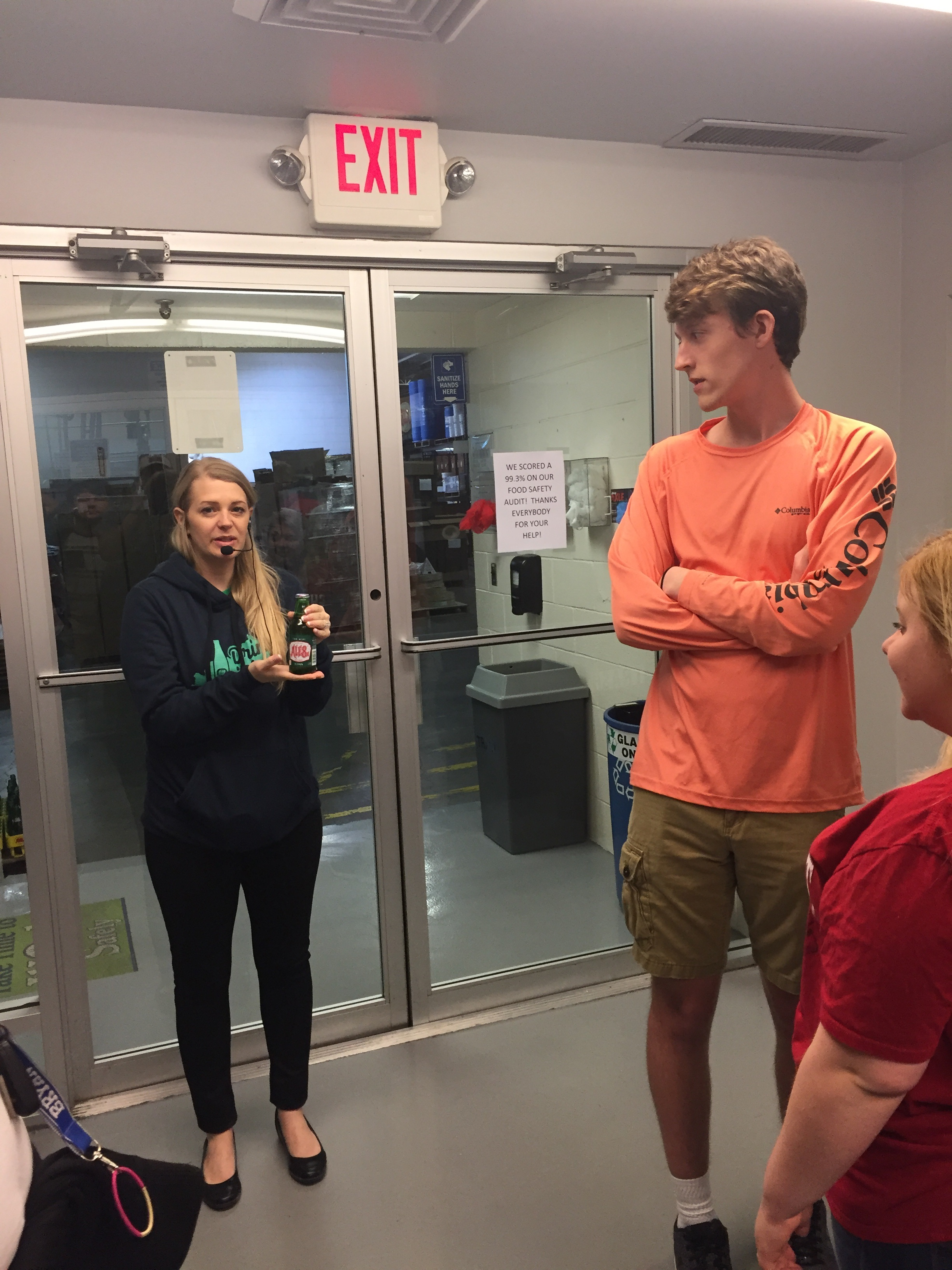 bryson tucker and abby taylor listen as the guide discusses their new bottle size