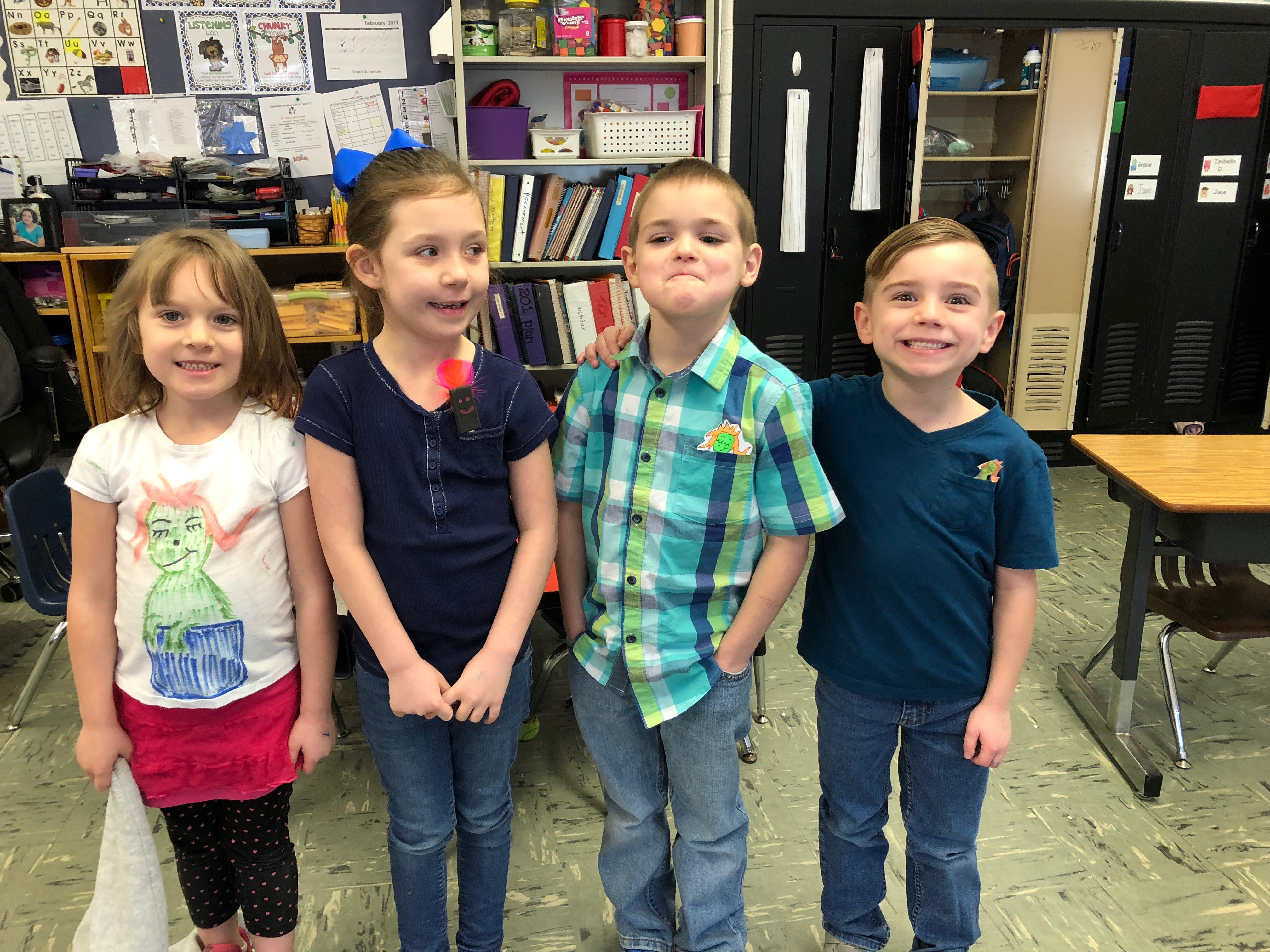 (L-R) Olivia Branscum, Paisley Coffey, Bryson Brown, and Zander Webb from Jill Allen's kindergarten class show off their wockets in their pockets