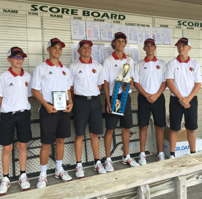 Golf team standing with trophy