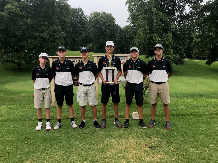Golf team holding plaques