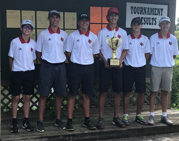 Golf team holding trophy