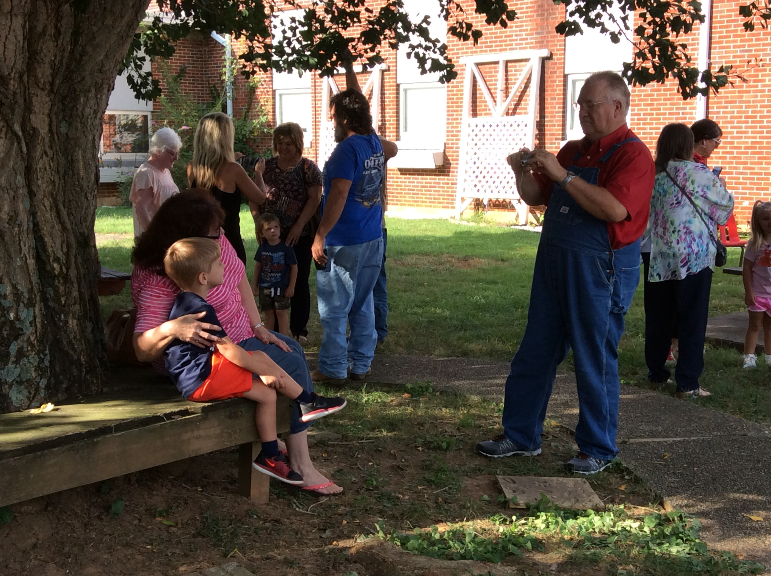 Denver Godsey takes a picture of his wife, Lea Etta and grandson Mathias McWhorter during Grandparents Week at Walker.