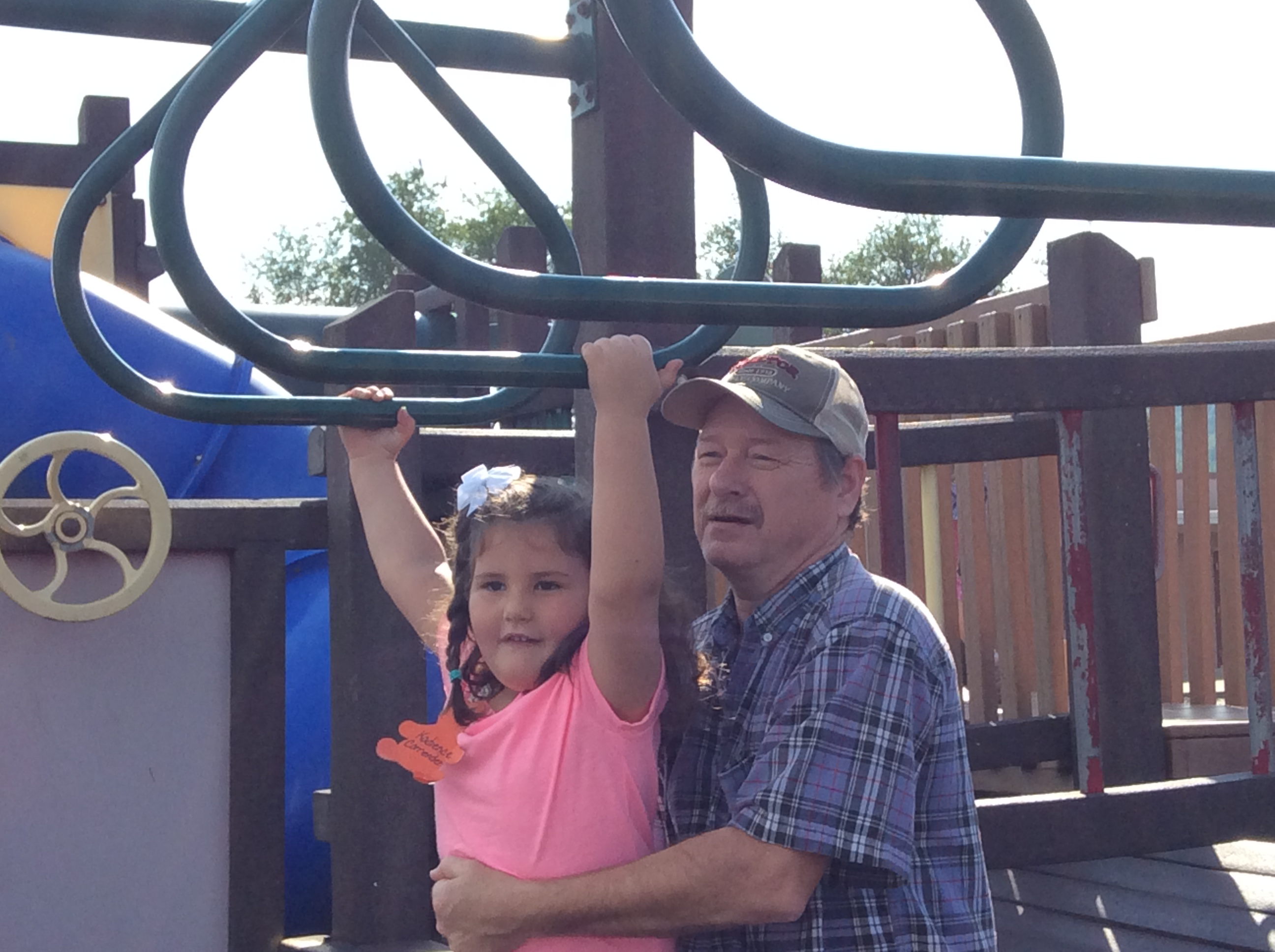Kadience Carrender gets help from grandpa Dwight Watson on the monkeybars during Grandparents Week, Ms. Hellen Duncan's class.