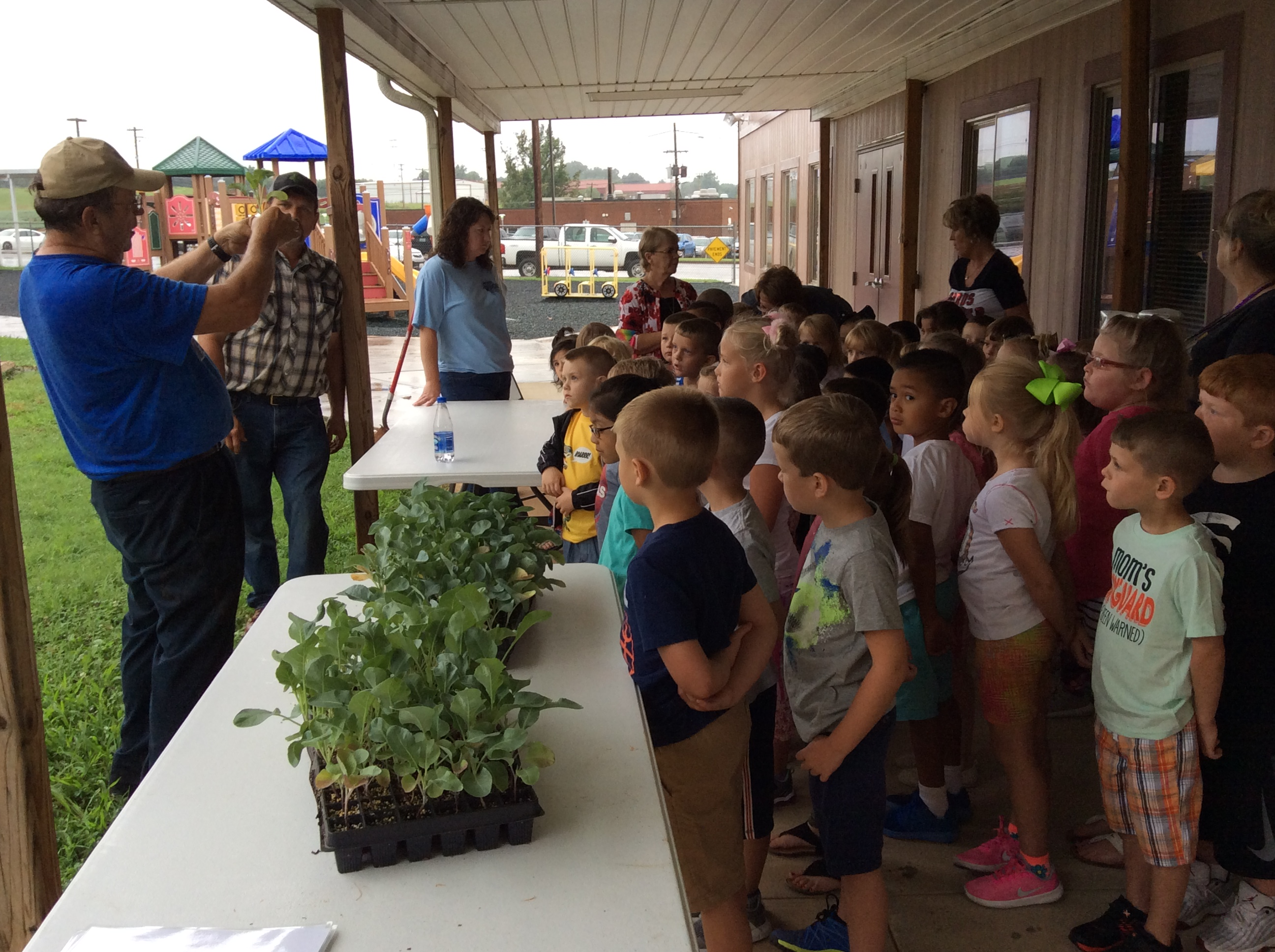 Glen Roberts teaching students about the broccoli plant.